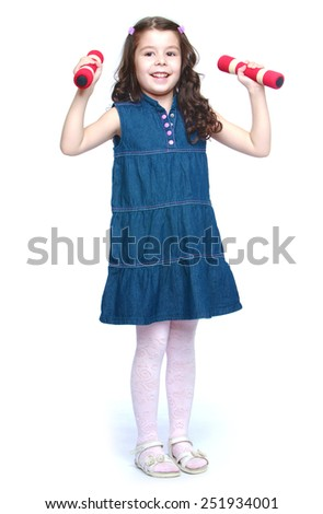 little girl raises dumbbell over your head.Isolated on white background, Lotus Children's Center. - stock photo