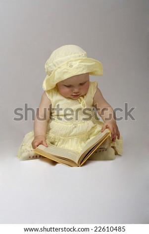 little girl read a book - stock photo