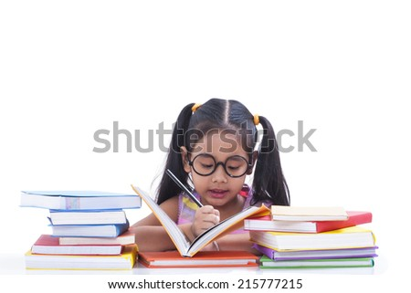 Little girl read and writing book - stock photo