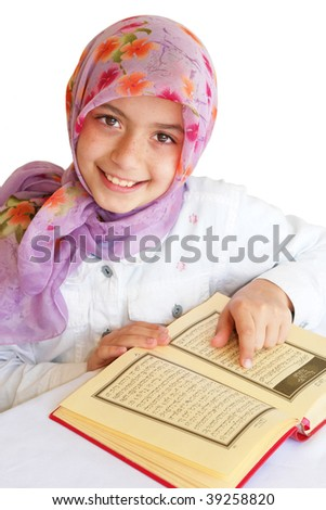 Little girl read holy Koran and smiles - stock photo