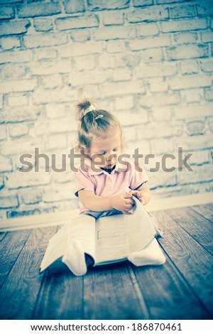 Little girl read magazine  - stock photo