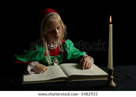 Little girl reading a book. - stock photo