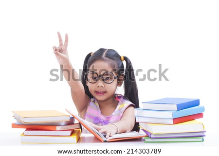 Little girl reading a book and hand show gesturing.