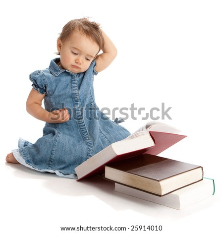 Little girl reading a book and scratching her head - stock photo