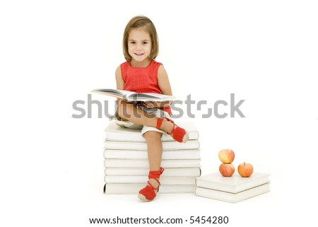 little girl reading a book isolated on white - stock photo