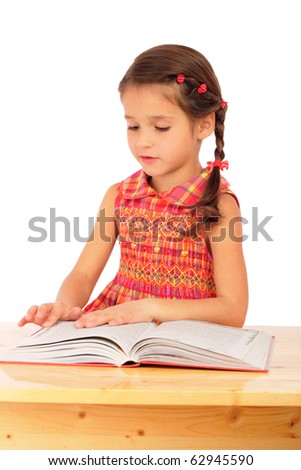 Little girl reading book on the desk, isolated on white
