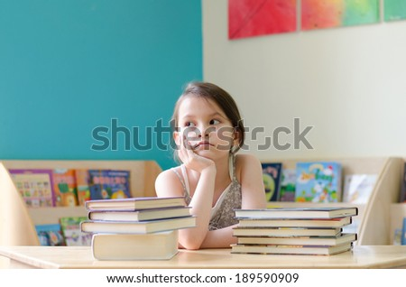 Little girl reading book thinking face