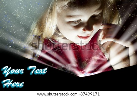 Little girl reading the book, See my portfolio for more - stock photo