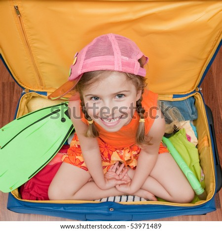 Little girl ready for summer vacation - stock photo