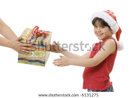 little girl receiving a present from an adult - stock photo