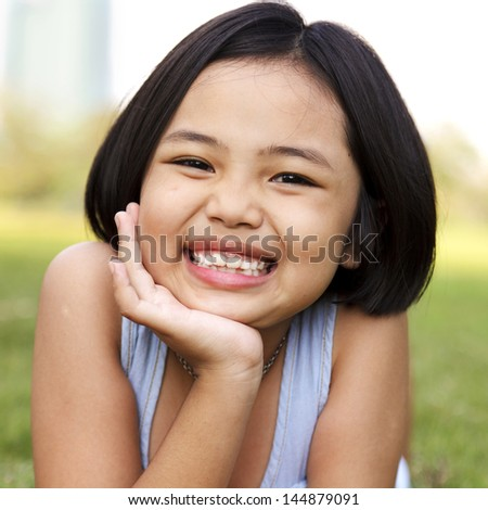 Little girl relax and smiling in the park