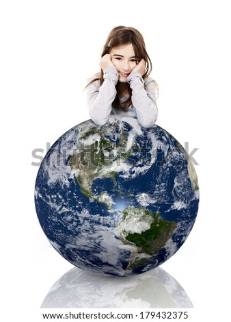 Little girl resting with her arms over a small planet earth, isolated on white background - Image of planet provided by Nasa - stock photo