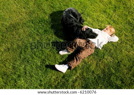 Little girl resting with her dog in the sun
