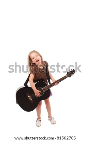 Little girl rocking with a large guitar - stock photo