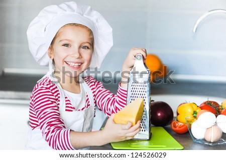little girl rubbing cheese - stock photo