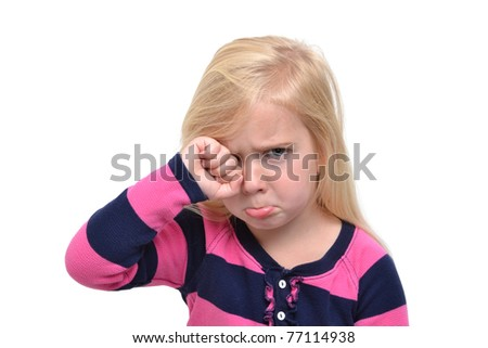 little girl rubbing her eyes crying - stock photo