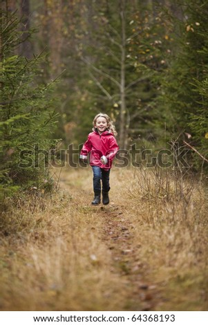 Little Girl running in the forest