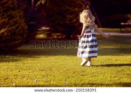 little girl running on the nature - stock photo