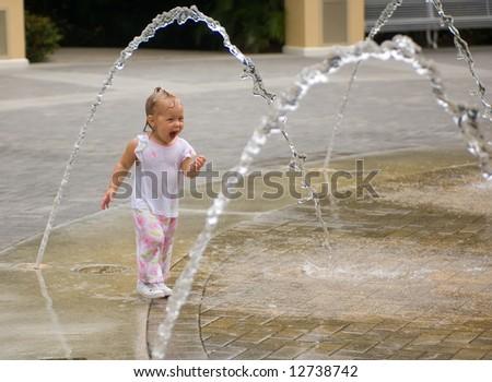 Little Girl Running Through Water - stock photo