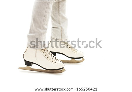 Little Girl's Legs in White Ice Skates.  Isolated On White Background