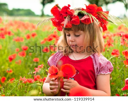 Little girl's portrait in poppies