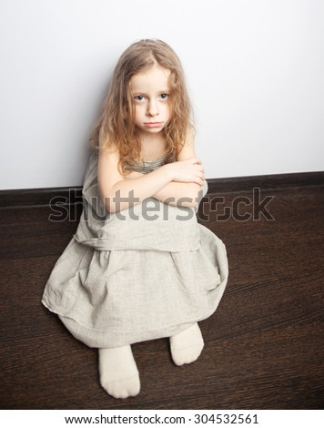 little girl sad