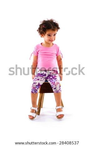 Little Girl seating in wood stool . - stock photo