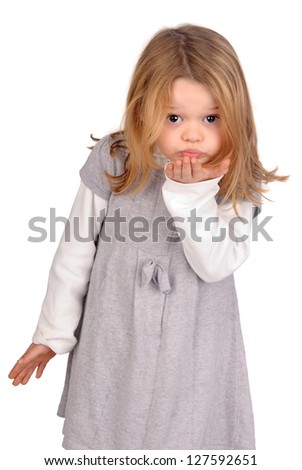 little girl sending a kiss - stock photo