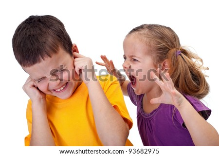 Little girl shouting in anger to a boy - raging kids - stock photo