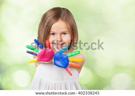 Little girl show painter hand. - stock photo