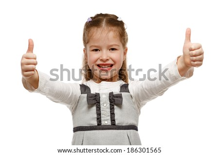 Little girl showing OK sign with both hands. - stock photo