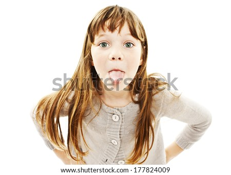 Little girl showing the tongue. Isolated on white background  - stock photo