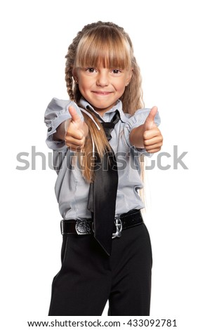 Little girl showing thumbs up gesture, isolated on white background - stock photo