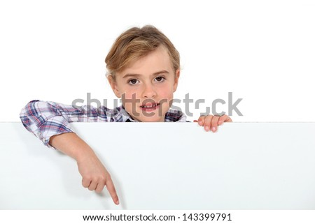 Little girl showing white sign for message - stock photo