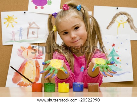 Little girl shows her painted hands - stock photo