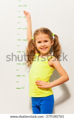 Little girl shows how she will grow up this year - stock photo