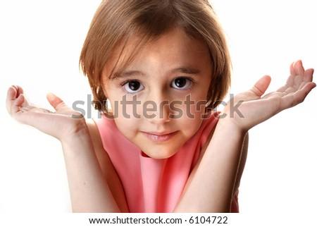 little girl shrugs shoulders stock photo edit now 6104722