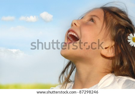 Little girl singing on meadow - stock photo