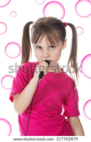 Little girl sings in background bubbles. - stock photo