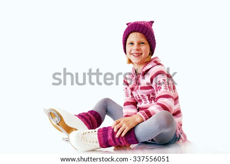 Little girl sits on the ice in ice skating. Isolated on white background. Winter fun - stock photo