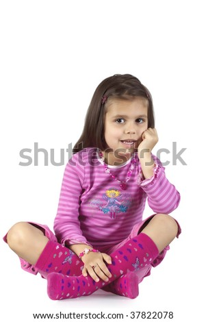 Little girl sits with her legs crossed and hands on Face. - stock photo