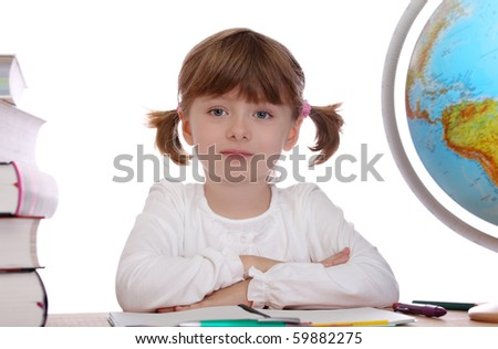 Little girl sitting  at a table - stock photo
