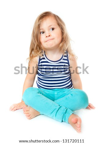 Little girl sitting, isolated over white