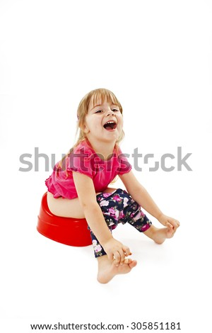 Little girl sitting on a chamber pot. Isolated on white background  - stock photo