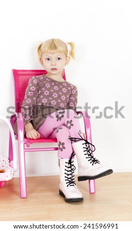 little girl sitting on chair - stock photo