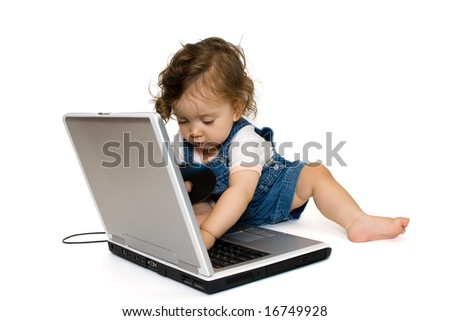Little girl sitting on laptop,with cd in her hand, isolated