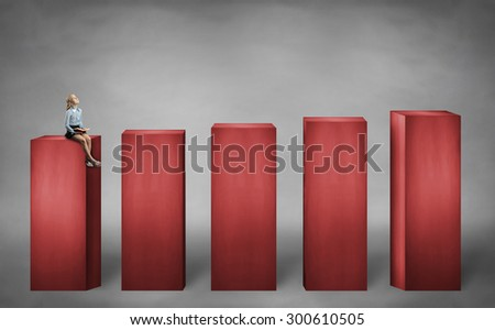 little girl sitting on lower stage - stock photo