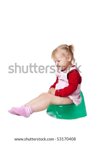 little girl sitting on potty - stock photo