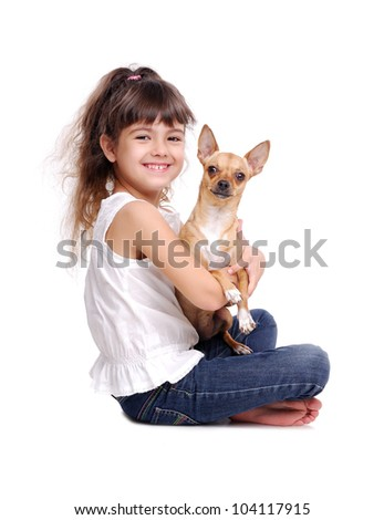 Little girl sitting on the floor with her chihuahua dog - stock photo