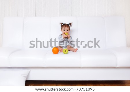 Little girl sitting on the soda with fruit - stock photo